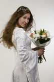 Bride with bunch of flowers. Studio portrait Royalty Free Stock Photo