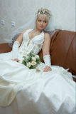 Bride with a bunch of flowers. Beautiful bride with a bunch of flowers before the  wedding ceremonial Stock Image