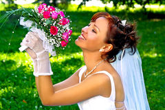 Bride with the bunch of flowers Royalty Free Stock Image