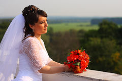 Bride with the bunch of flowers. Sun weather Stock Image