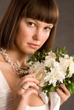 Bride with the bunch of flowers Stock Photos