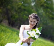 Bride with callas flowers Stock Photos