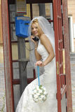 Bride calling by phone royalty free stock photo