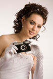 Bride with camera Stock Photo