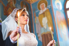 Bride with Candle at Church Stock Photo