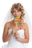 Bride with candy Royalty Free Stock Photos