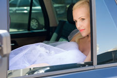 Bride in the car Royalty Free Stock Photography