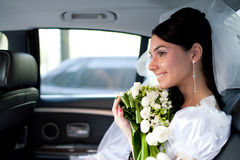 Bride in the car Stock Photos