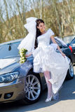 Bride by the car Royalty Free Stock Image