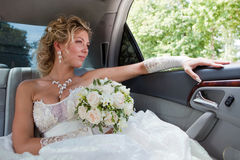 Bride in the car Royalty Free Stock Image