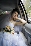 Bride in car Royalty Free Stock Photography