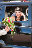 Bride in a car Stock Image