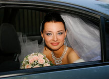 Bride in the car Royalty Free Stock Images