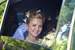 Bride in a car Royalty Free Stock Image