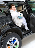 Bride in car. Young happy bride looks out of car stock images