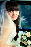 Bride in the car. Royalty Free Stock Photography