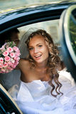 Bride in a car. Portrait of a pretty bride in a car stock photography