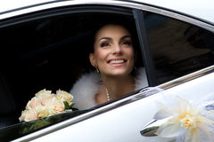 Bride in a car Stock Images