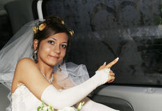 Bride in car Stock Images