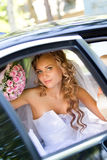 Bride in a car Royalty Free Stock Photo