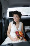 Bride in a car Royalty Free Stock Photography