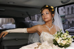 Bride in car. Portrait of beautiful happy bride in car Stock Photos