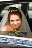 Bride in the car. Young beautiful bride in the car Royalty Free Stock Images