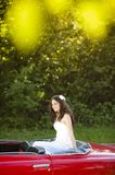 Bride and car Royalty Free Stock Image
