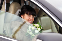Bride in a car at her wedding day Stock Photo
