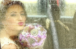 Bride in the car on a rainy day Royalty Free Stock Images