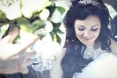 Bride in car window Royalty Free Stock Image
