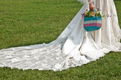 Bride carrying flowers Royalty Free Stock Photography