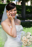 Bride on Cell Phone. Happy bride talking over cell phone Royalty Free Stock Photo
