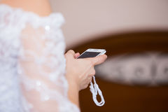 Bride with cell phone Stock Images