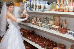 Bride in ceramics store Royalty Free Stock Photos