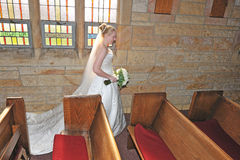 Bride in the chapel Stock Images