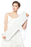 The bride with a cheerful smile holding a blank poster. stock images