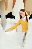 Bride chooses bridal gown in wedding boutique Stock Photography