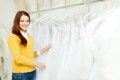 Bride chooses wedding outfit at shop Royalty Free Stock Image
