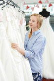 Bride Choosing Dress In Bridal Boutique Stock Photography