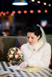 Bride choosing menu Royalty Free Stock Image