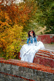 Bride in city park Royalty Free Stock Images