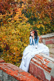 Bride in city park Royalty Free Stock Image