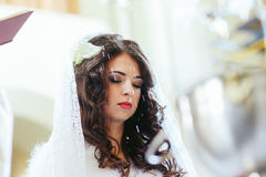 Bride with closed eyes during the ceremony Stock Photo