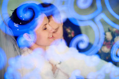 Bride with closed eyes and groom Royalty Free Stock Image