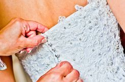 Closure of the bride dress Stock Image