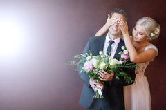 Bride closes her eyes at her husband. The bride closes her eyes at her husband and looks at him stock photo