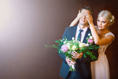 Bride closes to groom`s eyes Royalty Free Stock Photography