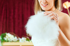 Bride at the clothes shop for wedding dresses Royalty Free Stock Images