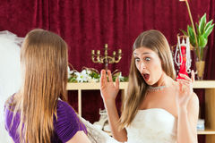 Bride at the clothes shop for wedding dresses Royalty Free Stock Photo